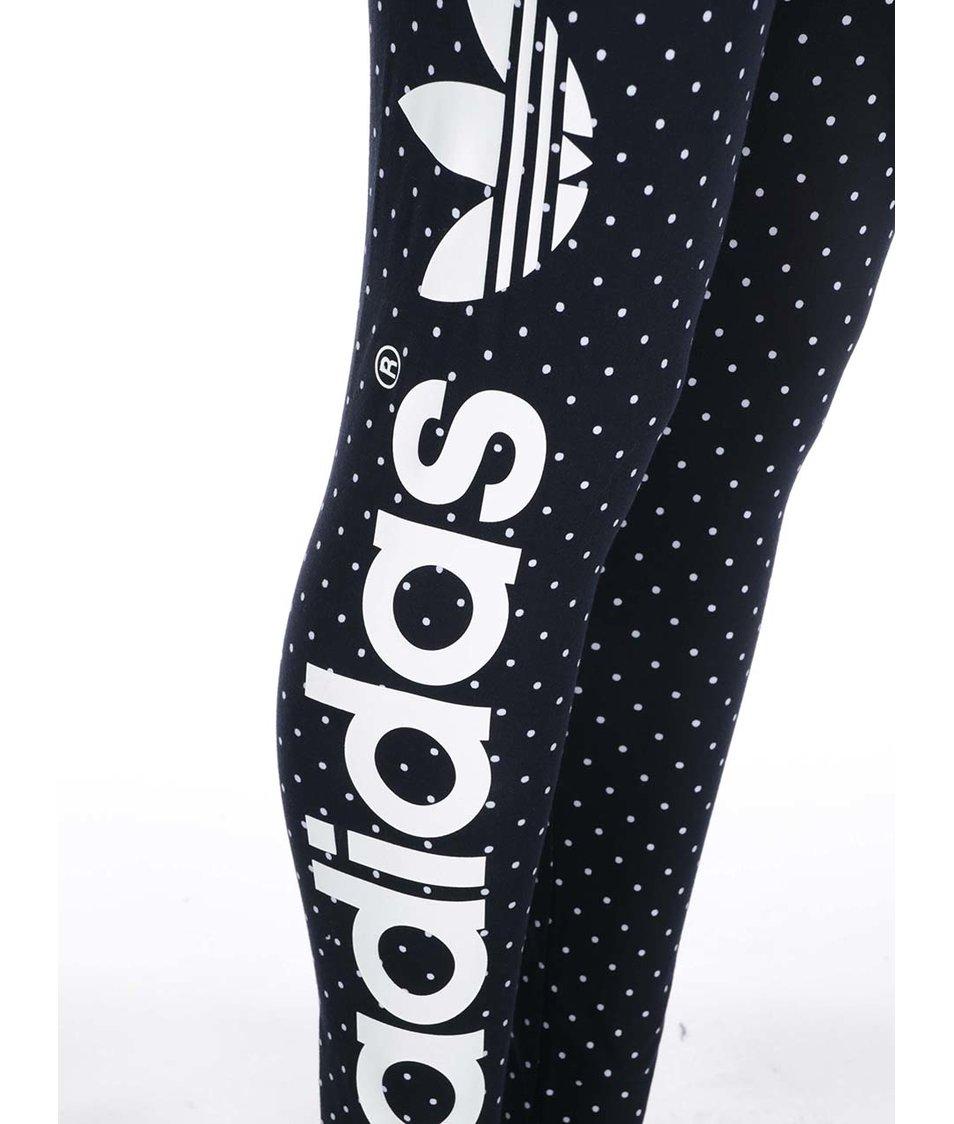 Tmavě modré dámské puntíkované legíny adidas Originals Dots