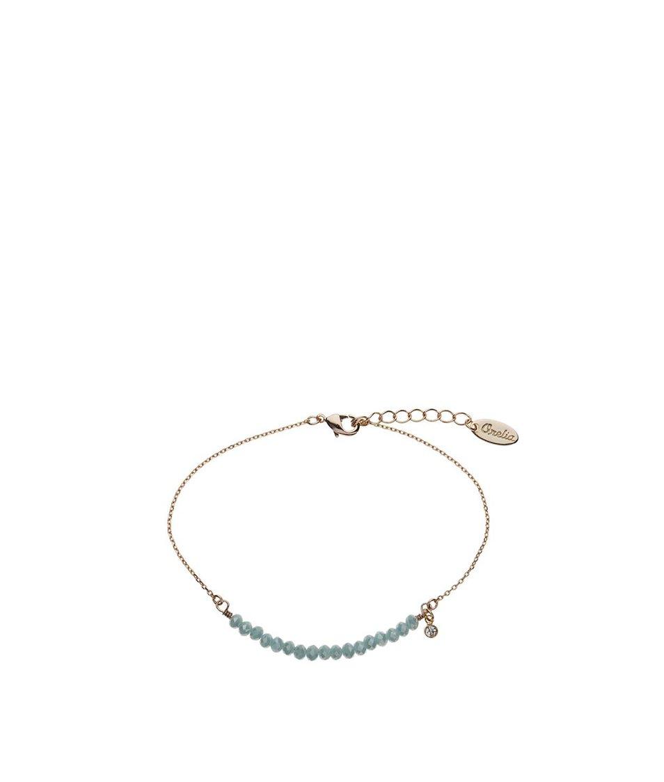 Náramek ve zlaté barvě s modrými korálky Orelia