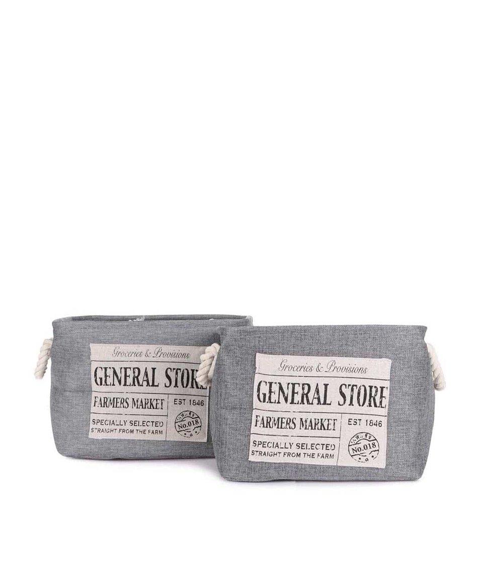 Sada dvou krémovo-šedých úložných košů s nášivkou Dakls