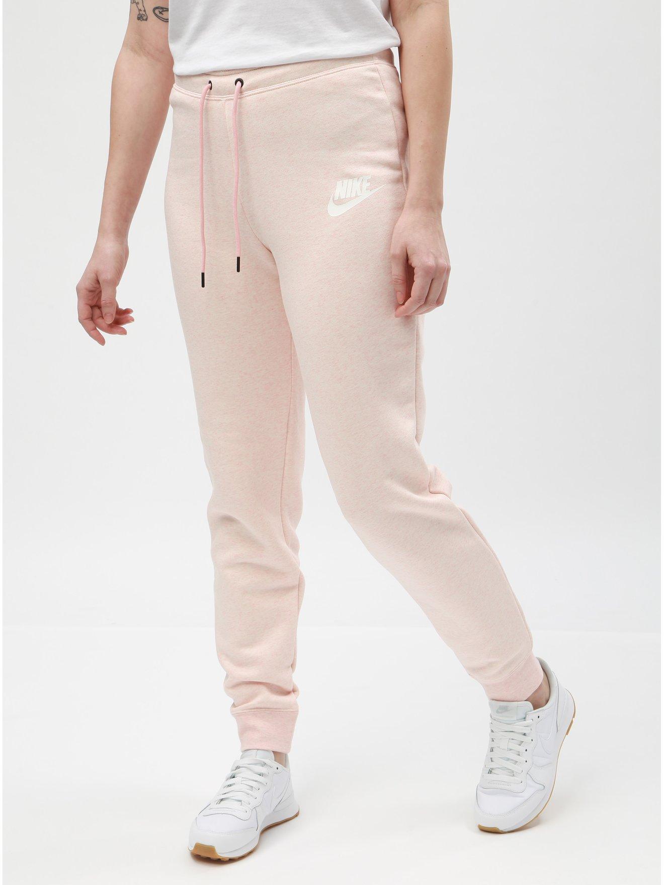 Světle růžové dámské žíhané tepláky Nike 08eb455d47