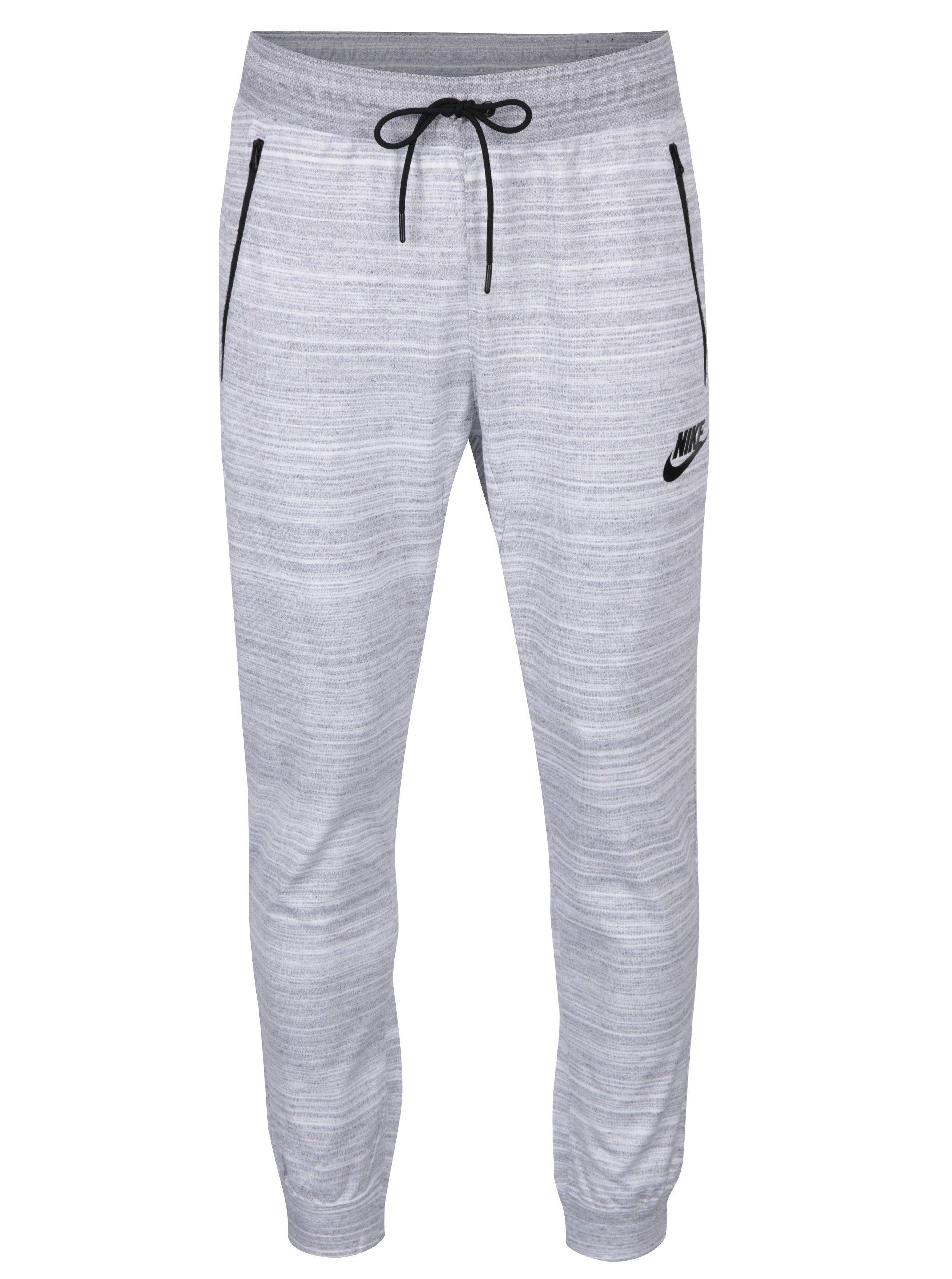 Krémovo-šedé žíhané pánské tepláky s kapsami Nike