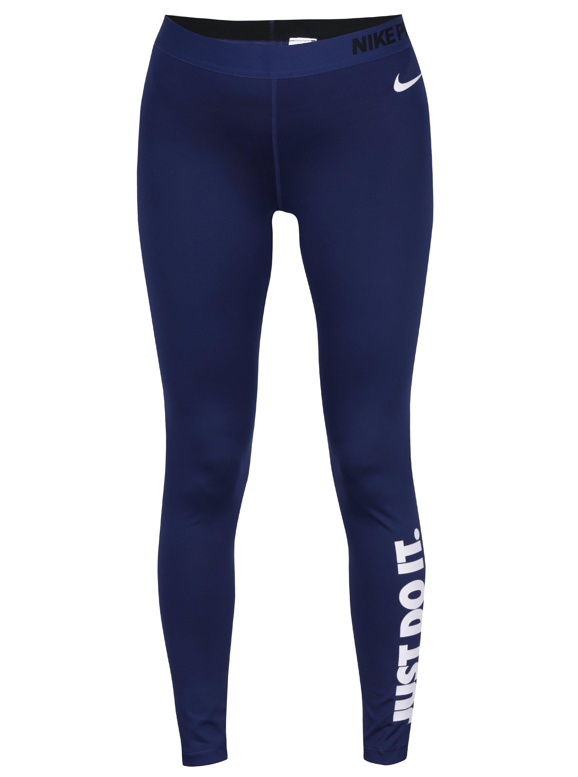 Tmavě modré dámské funkční legíny potiskem Nike