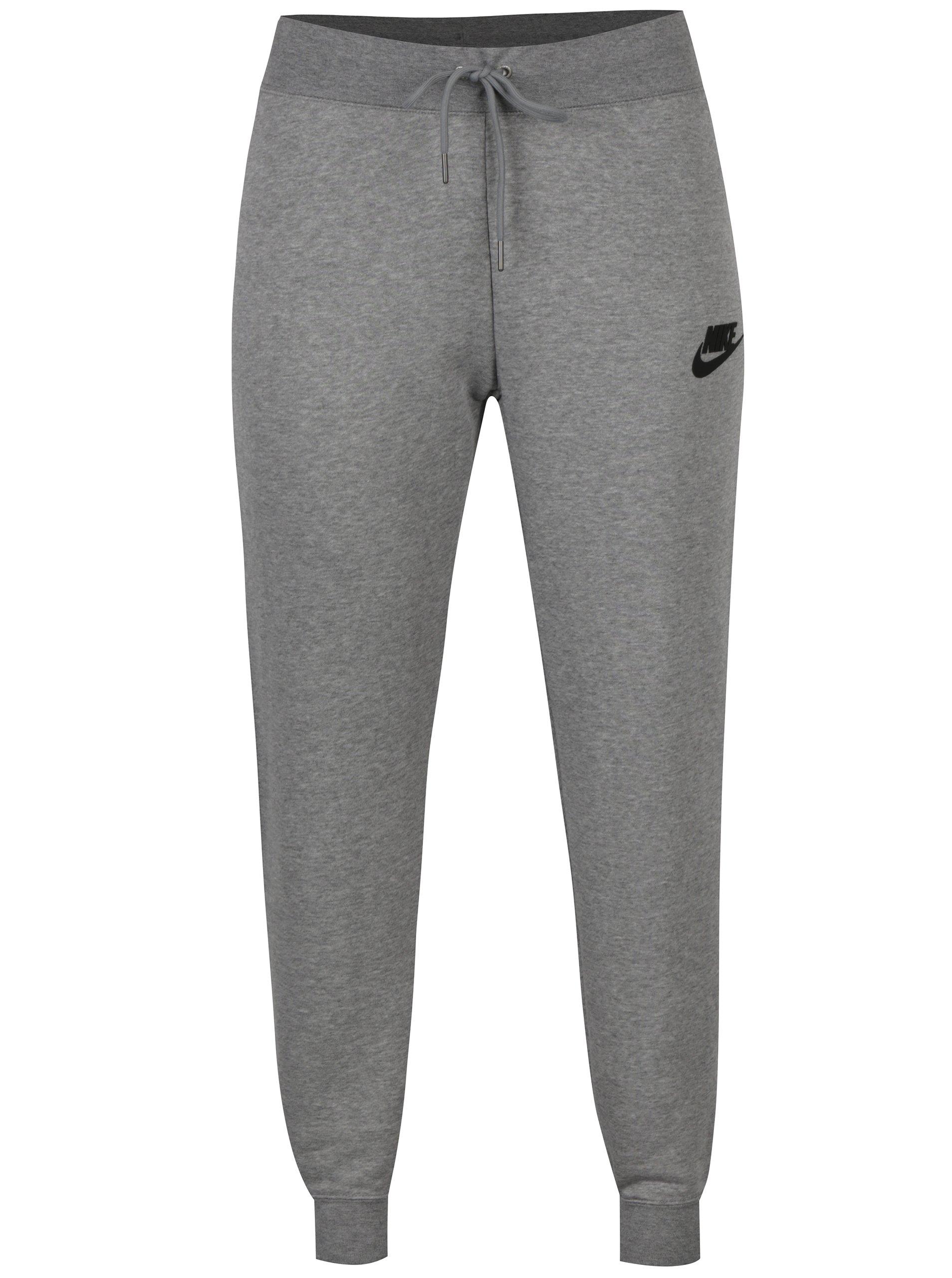 Světle šedé dámské slim fit tepláky Nike Sportswear Modern