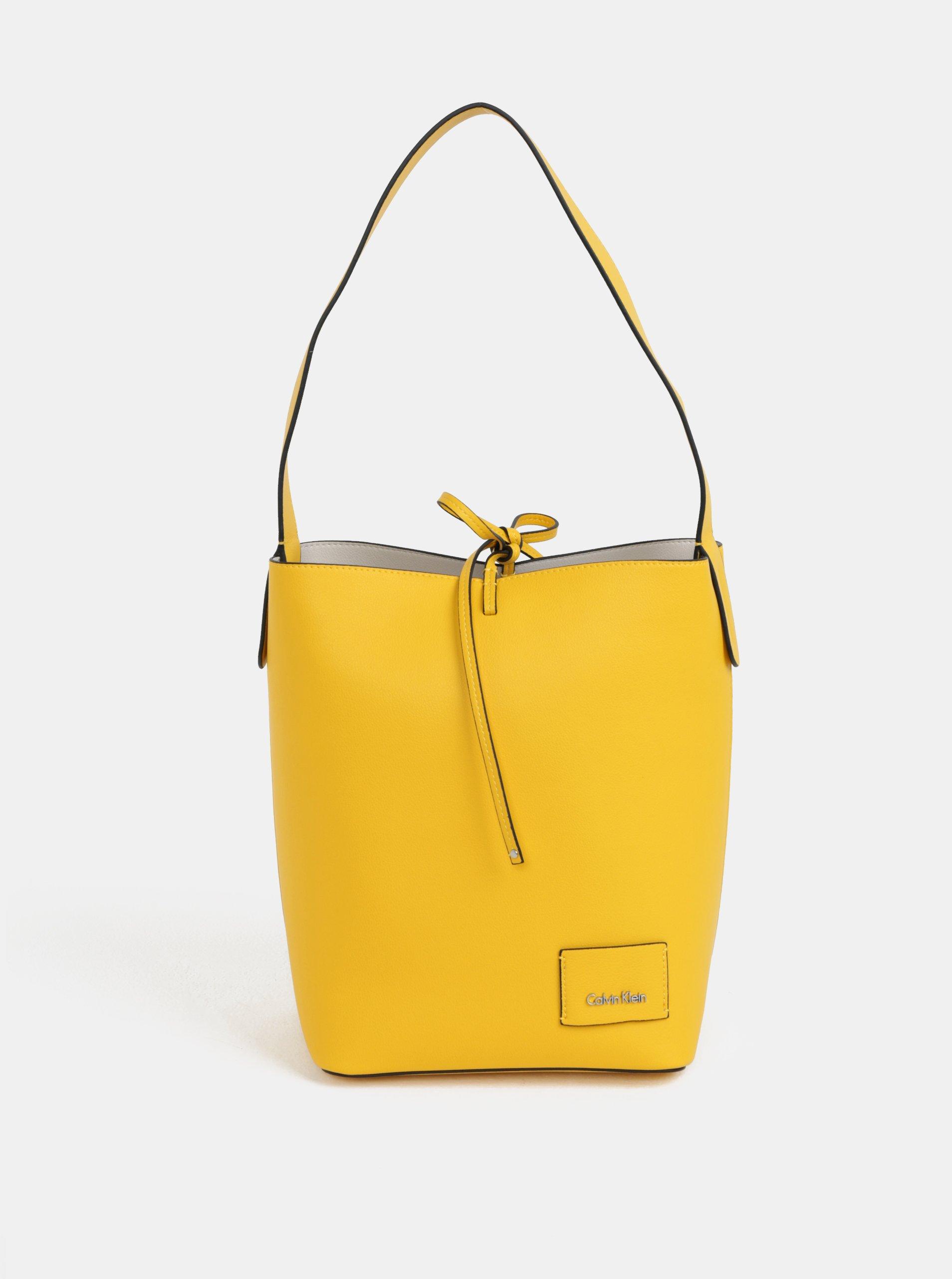 Žlutá velká koženková kabelka s pouzdrem Calvin Klein Jeans