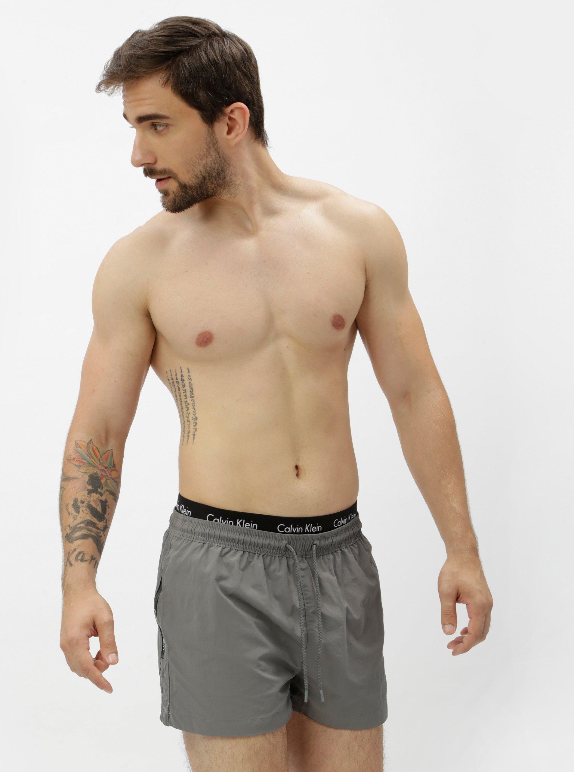 60c64f82f Šedé pánské plavky s gumou v pase Calvin Klein Underwear
