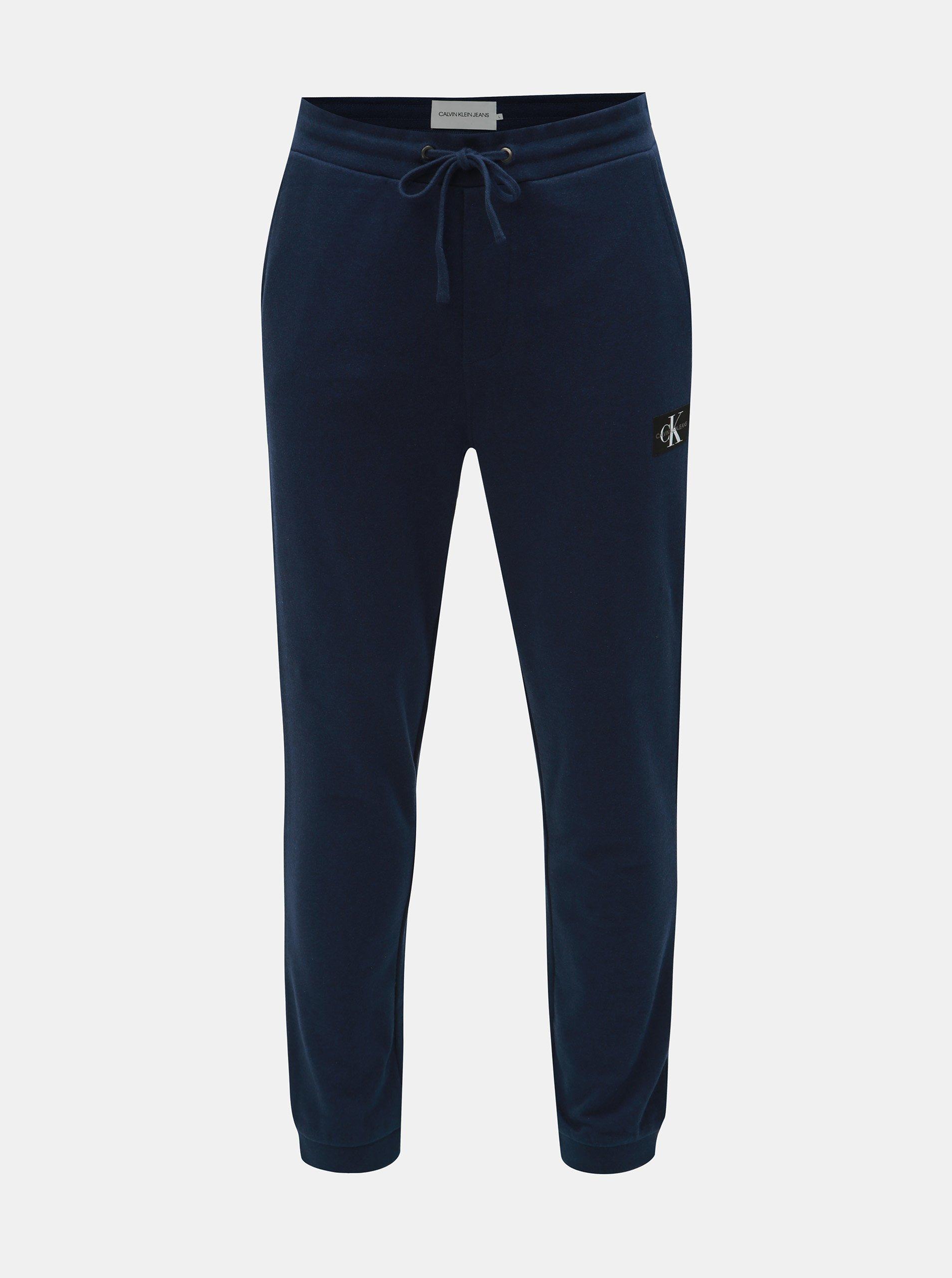 Tmavě modré pánské tepláky Calvin Klein Jeans