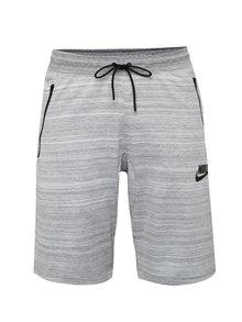 Svetlosivé melírované pánske slim fit teplákové kraťasy Nike Sportwear Advance 15