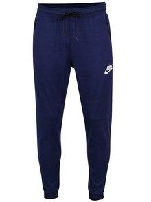 Tmavě modré pánské tepláky s kapsami Nike