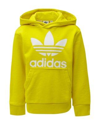 Žltá dětská mikina s kapucňou a klokaním vreckom adidas Originals Trefoil