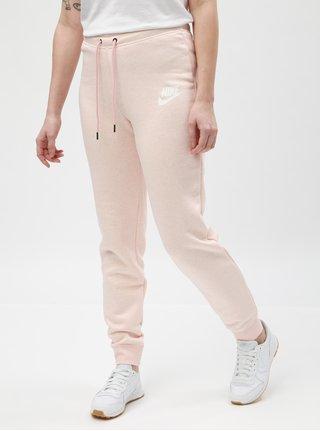 Světle růžové dámské žíhané tepláky Nike
