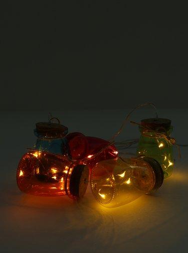 Červený LED svítící řetěz s dózičkami Kaemingk