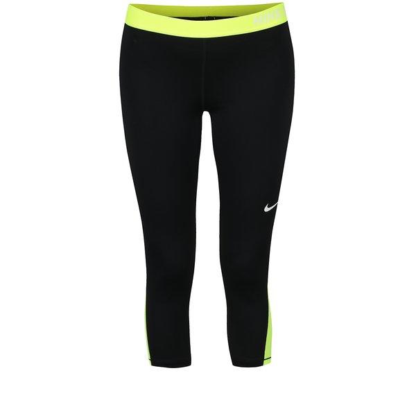 Colanți capri negru&galben neon Nike cu detalii în contrast de la Nike in categoria Blugi, pantaloni, colanți