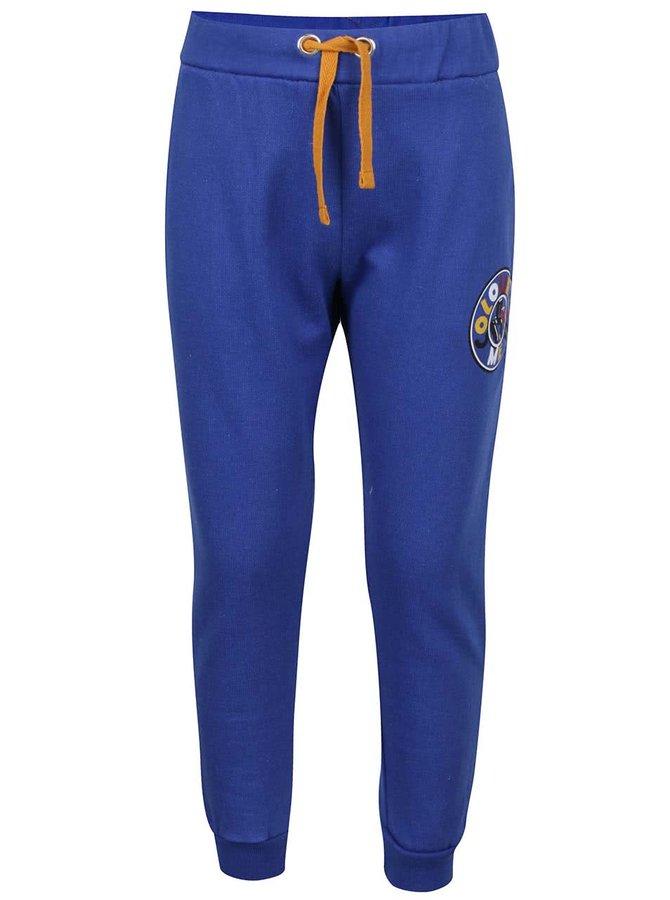 Tmavě modré klučičí tepláky s oranžovou šňůrkou 5.10.15.