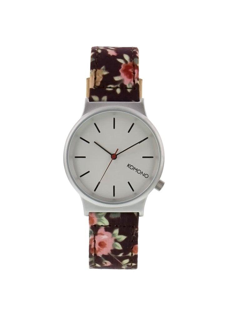 Dámské hodinky ve stříbrné barvě s tmavě hnědým květovaným textilním páskem Komono Wizard Print Roseberry