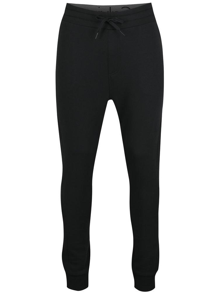 Čierne pánske tepláky s vreckami na zips Calvin Klein Jeans Hiro