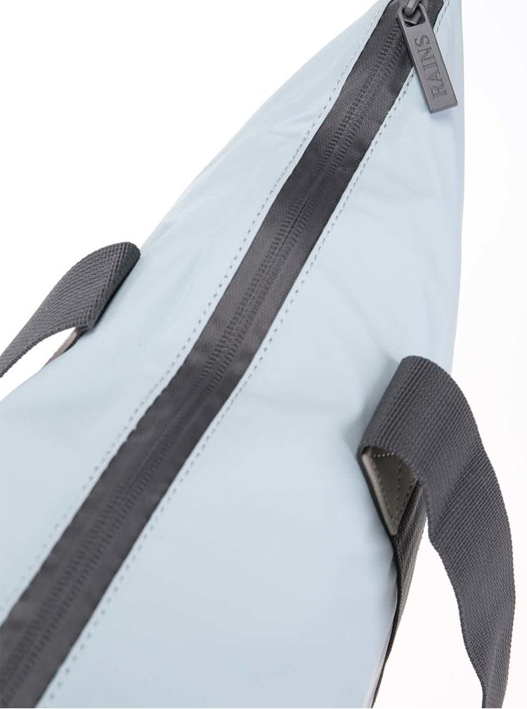 Svetlomodrá cestovná taška s dlhšími uchami RAINS