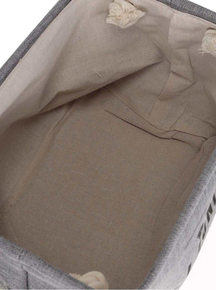 Sada dvou krémovo-šedých úložných košů s nápisem Dakls