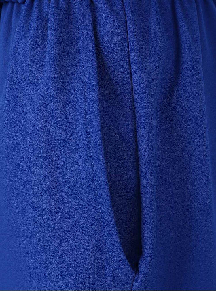 Tmavě modrý overal s průstřihy na ramenou Alchymi