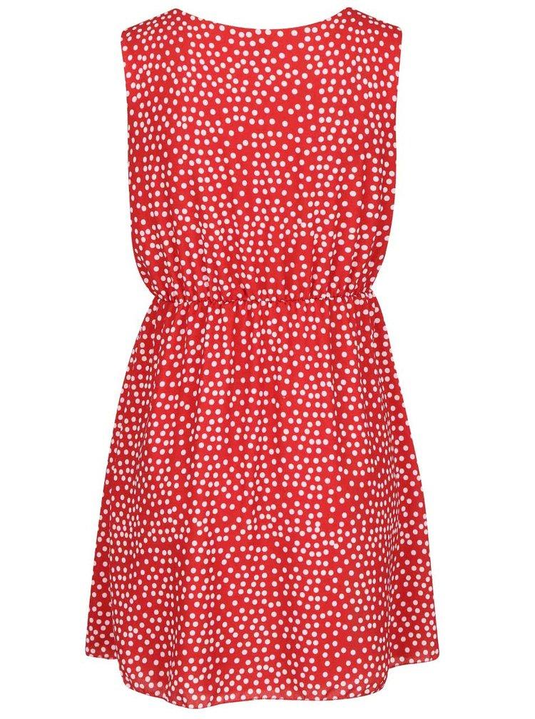 Červené šaty s bílými puntíky Madonna