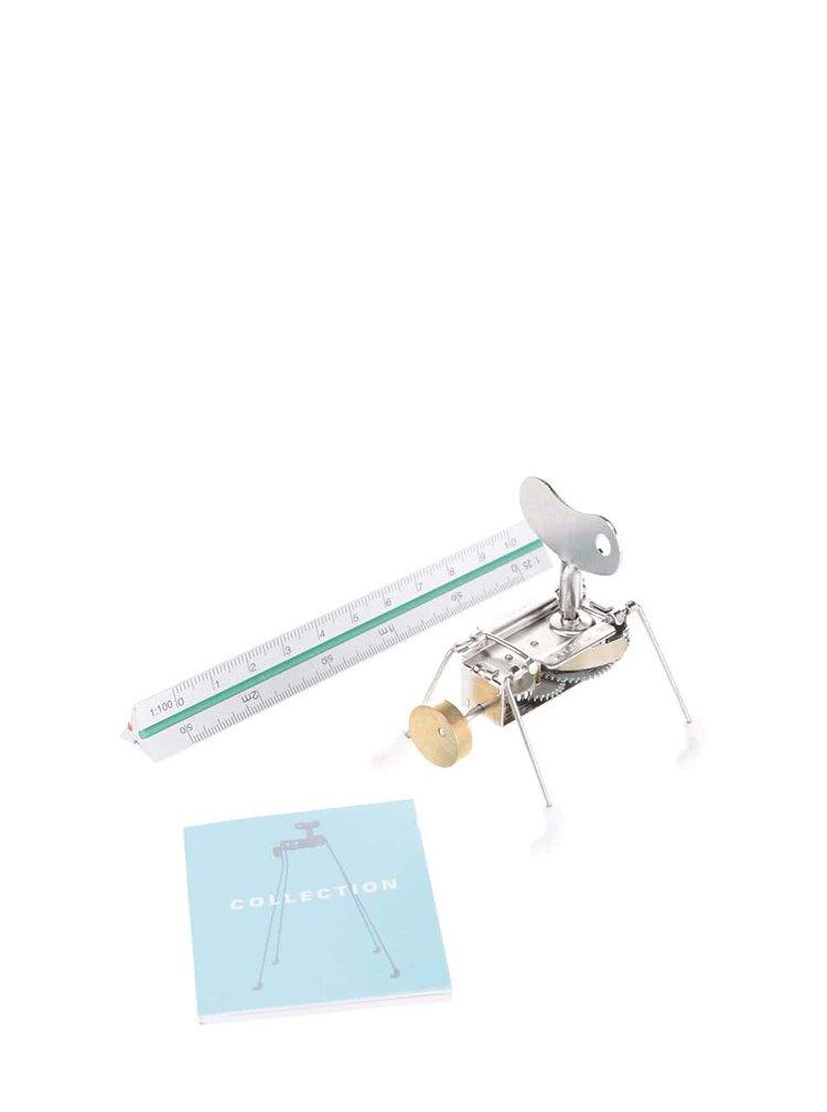 Hračka na kľúčik s bielymi nožičkami SPINNEY WIND UP Kikkerland