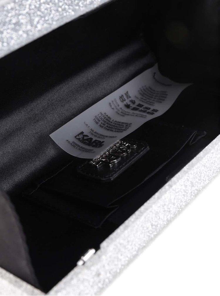 Krémovo-stříbrné třpytivé psaníčko s motivem letenky KARL LAGERFELD