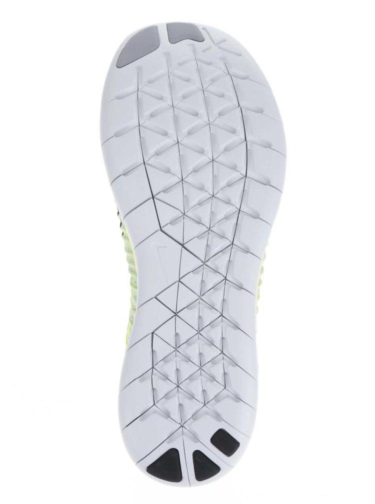 Šedo-zelené pánské žíhané tenisky Nike Free Fly