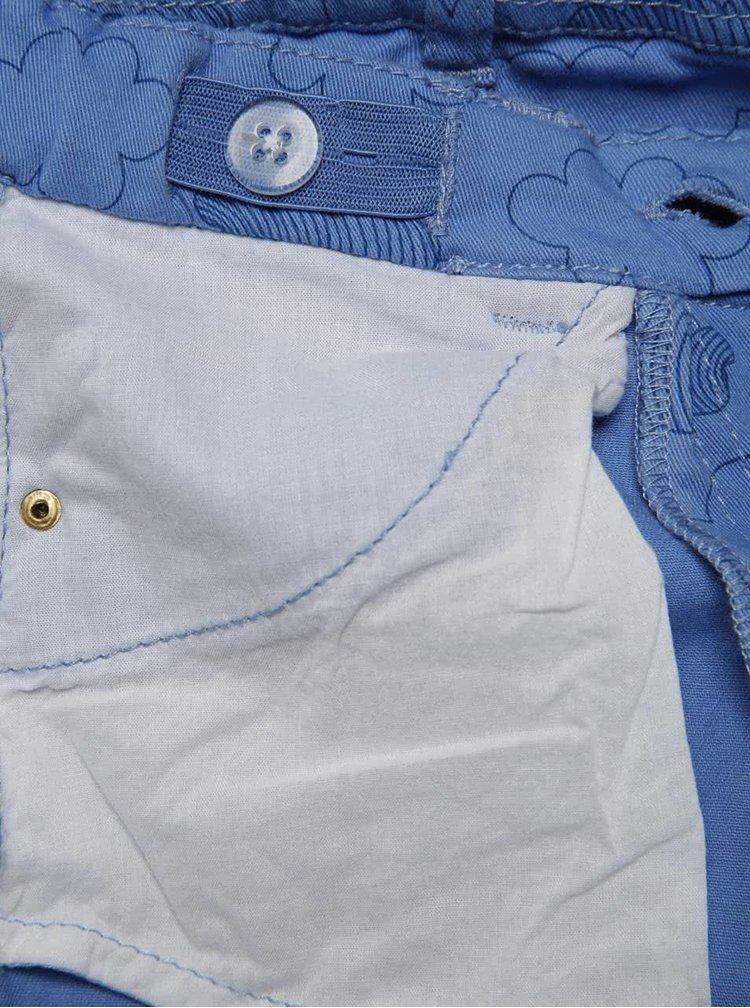 Modré holčičí kalhoty s jemným vzorem a nášivkami 5.10.15.