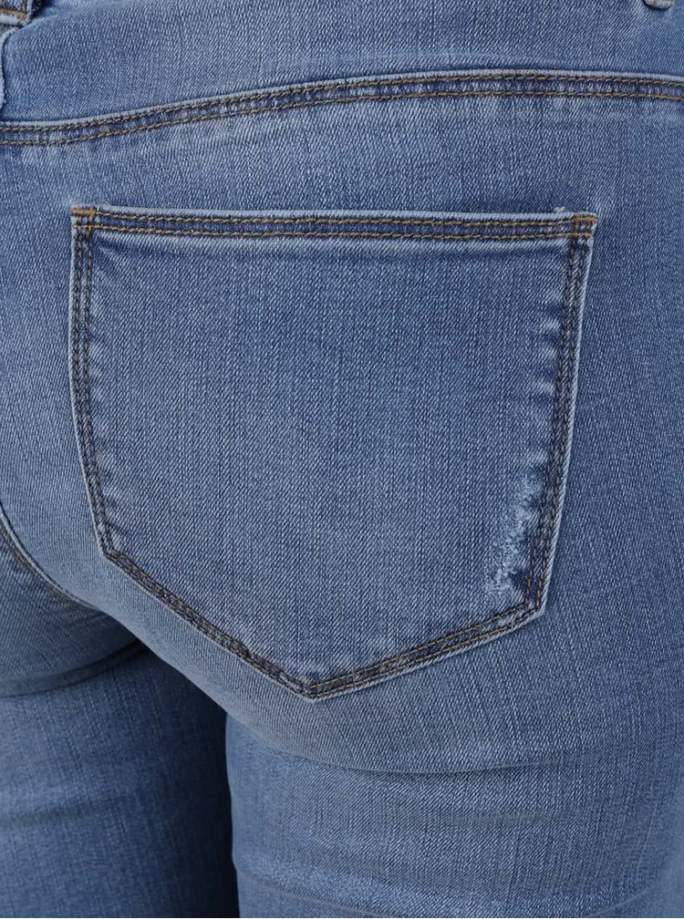 Modré zkrácené skinny džíny s potrhaným efektem ONLY Carmen