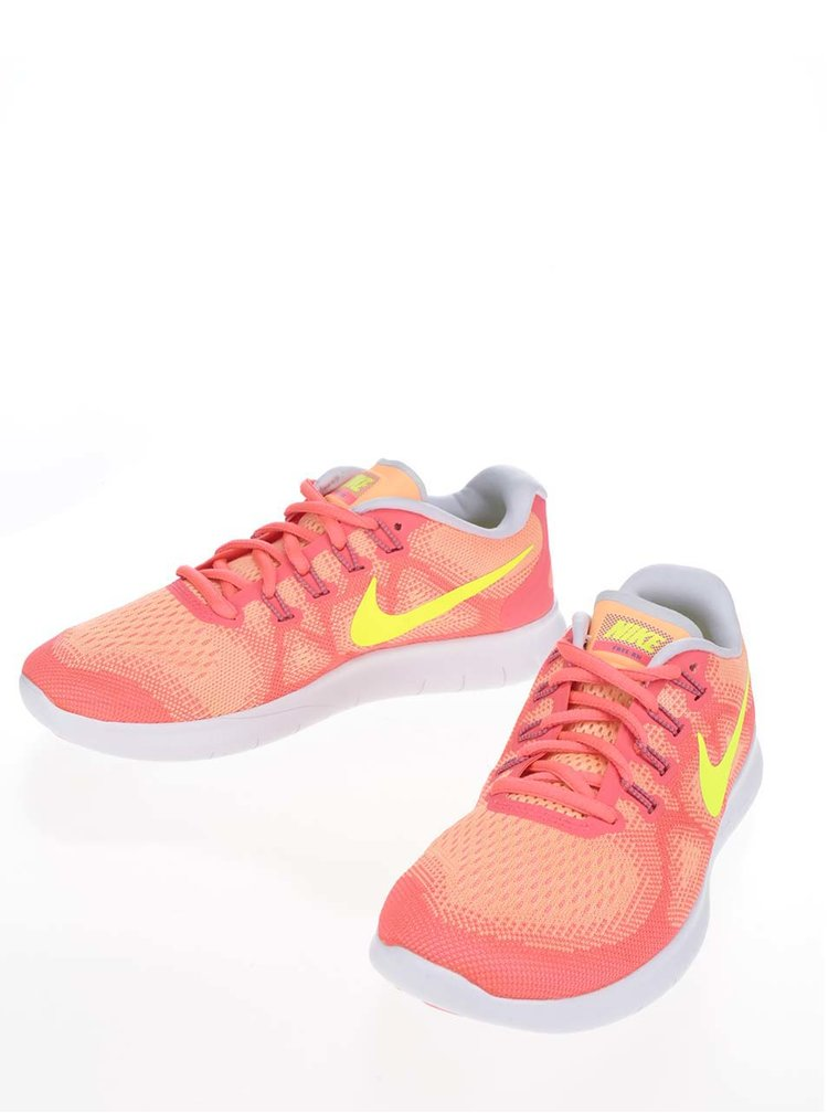 Oranžové dámské tenisky s logem Nike Free Commuter