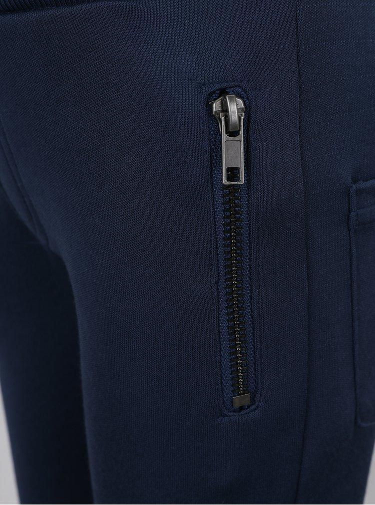 Tmavě modré klučičí tepláky s potiskem name it Holy Poly