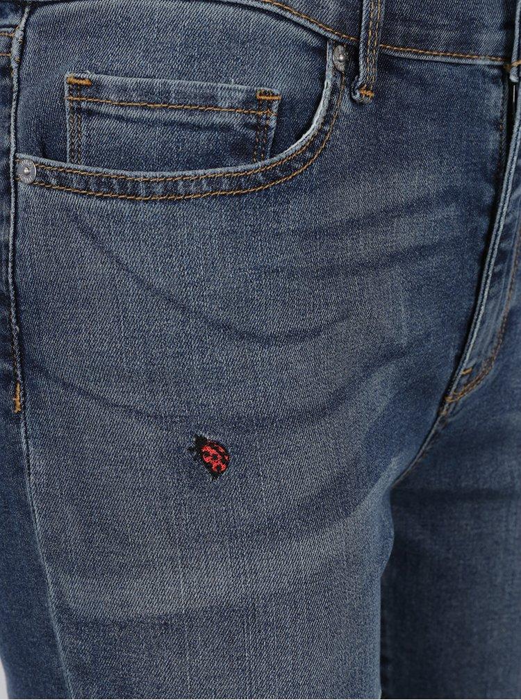 Modré zkrácené skinny džíny s výšivkami berušek Juicy Couture