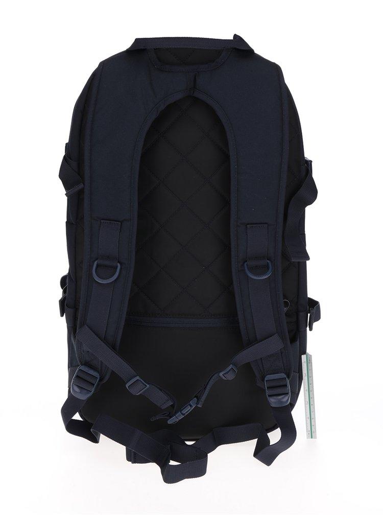 Tmavě modrý batoh s koženými detaily Eastpak Hutson 27 l
