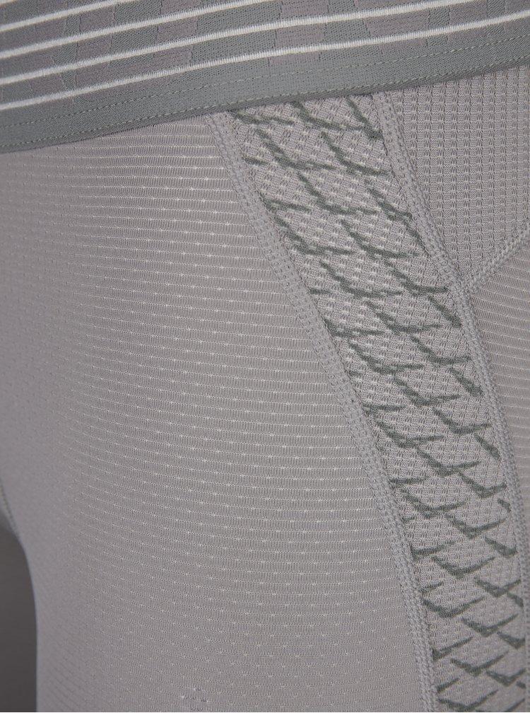 Světle šedé pánské funkční legíny Nike