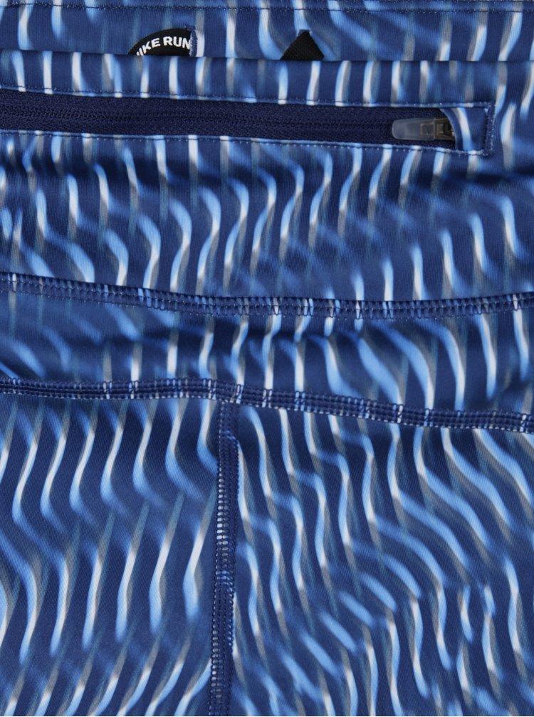 Tmavě modré dámské vzorované funkční 3/4 legíny Nike