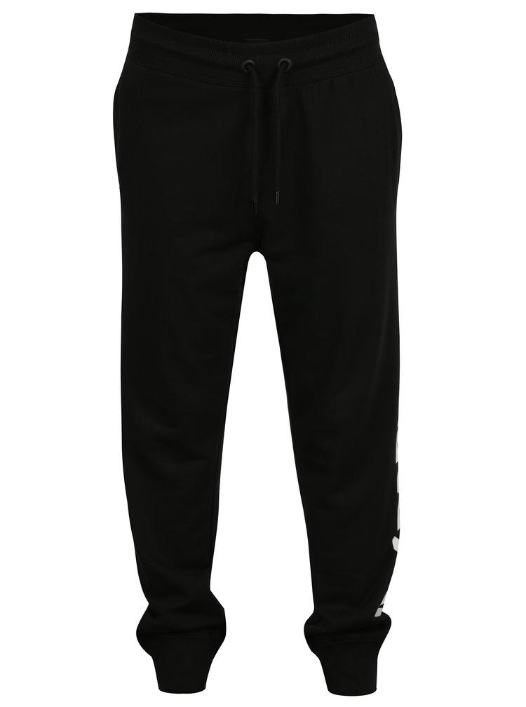 Černé tepláky s potiskem na nohavici Ivy Park