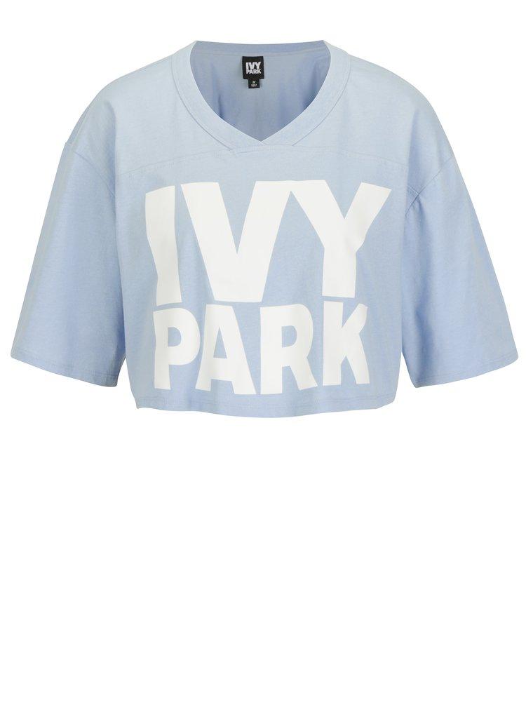 Světle modrý crop top s potiskem Ivy Park