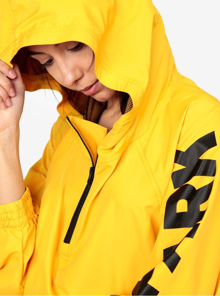 Žlutý šusťákový anorak s kapucí Ivy Park