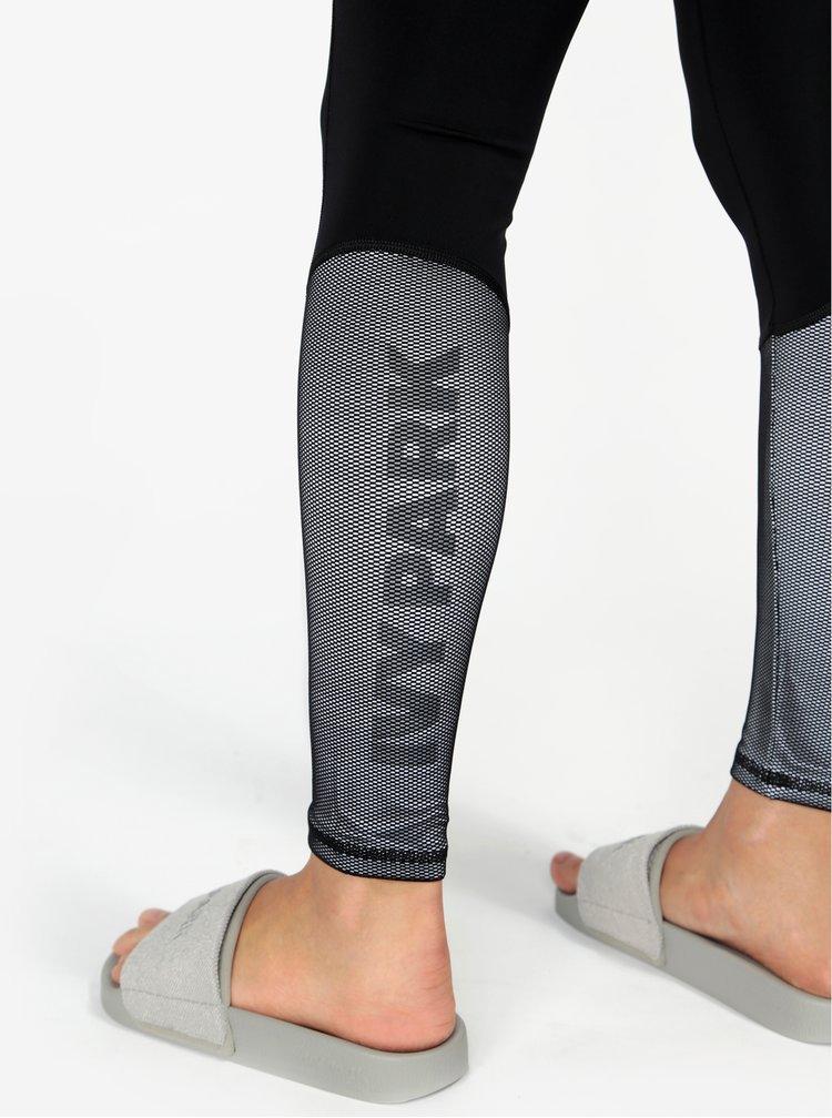Černé legíny se síťovanou částí na nohavicích Ivy Park