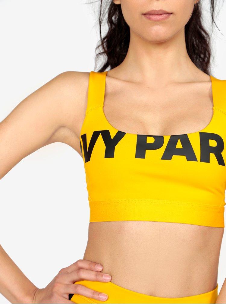 Žltá športová podprsenka s potlačou Ivy Park