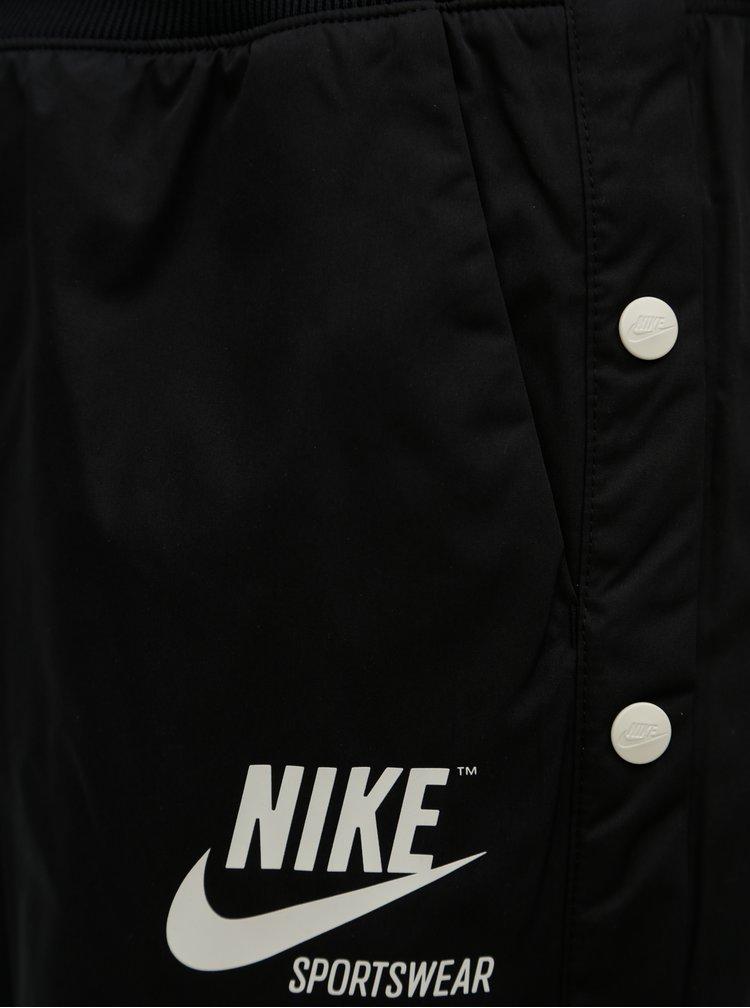 Černé dámské kalhoty s patentky na nohavicích Nike pant