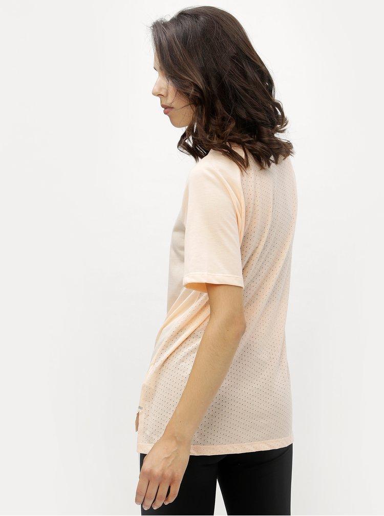 Meruňkové dámské funkční tričko Nike Tailwind