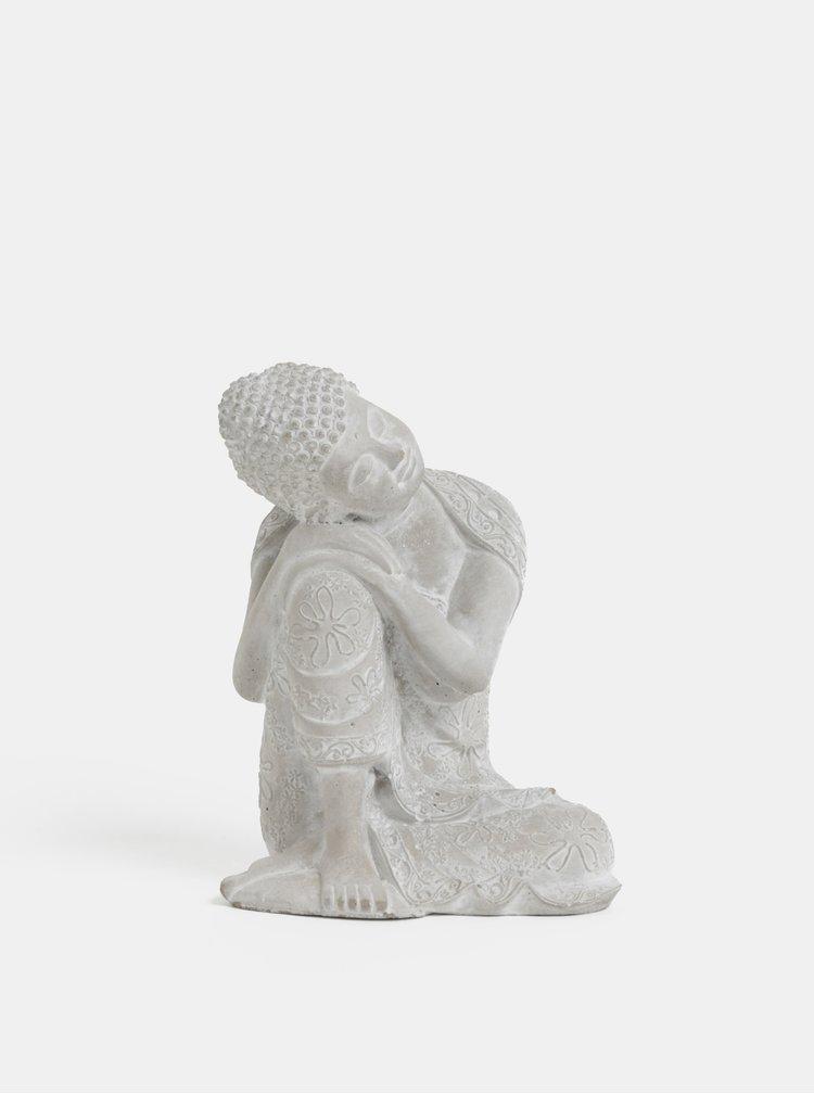 Šedá soška ve tvaru Buddhy Dakls