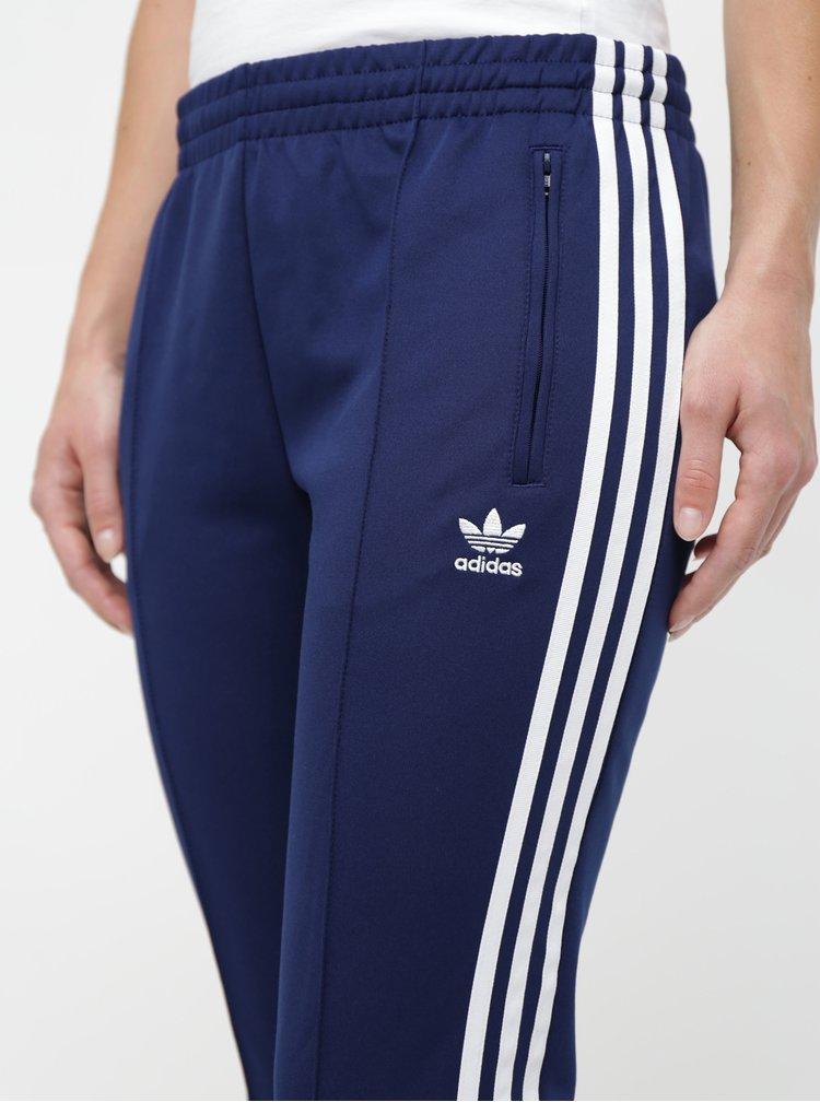 Tmavě modré dámské tepláky s pruhy adidas Originals