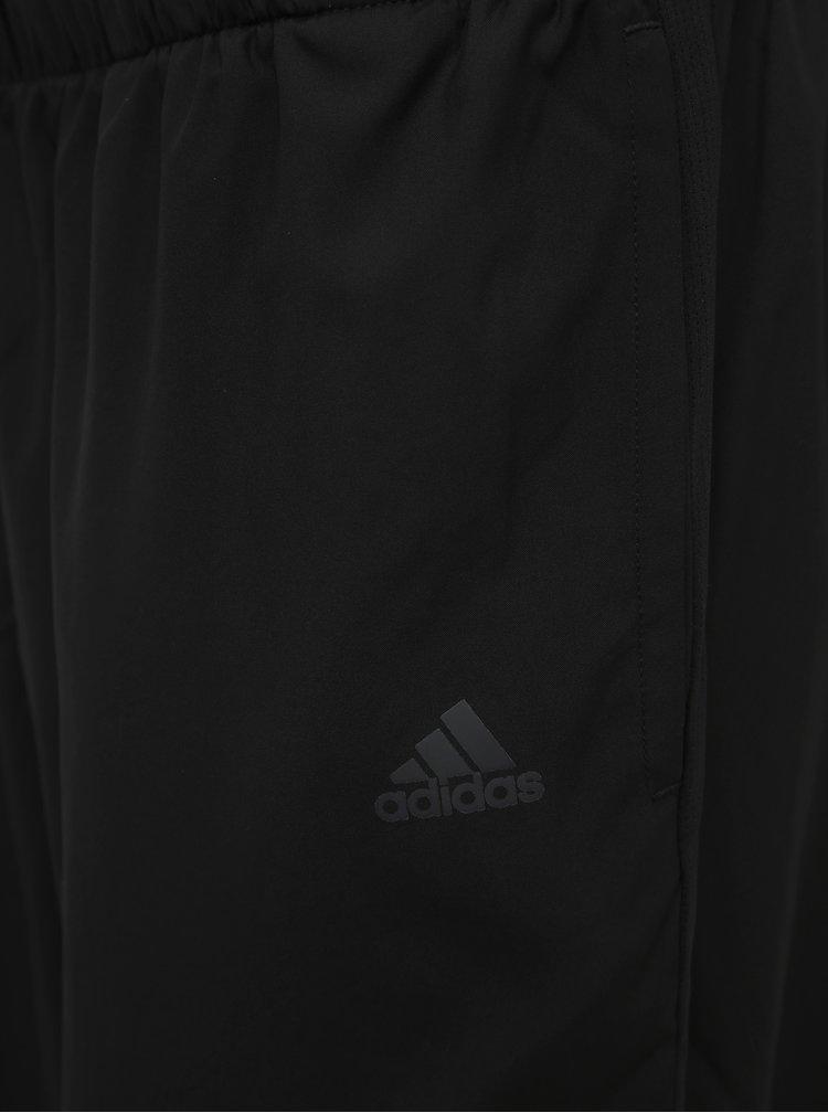 Černé dámské šusťákové kalhoty adidas Performance
