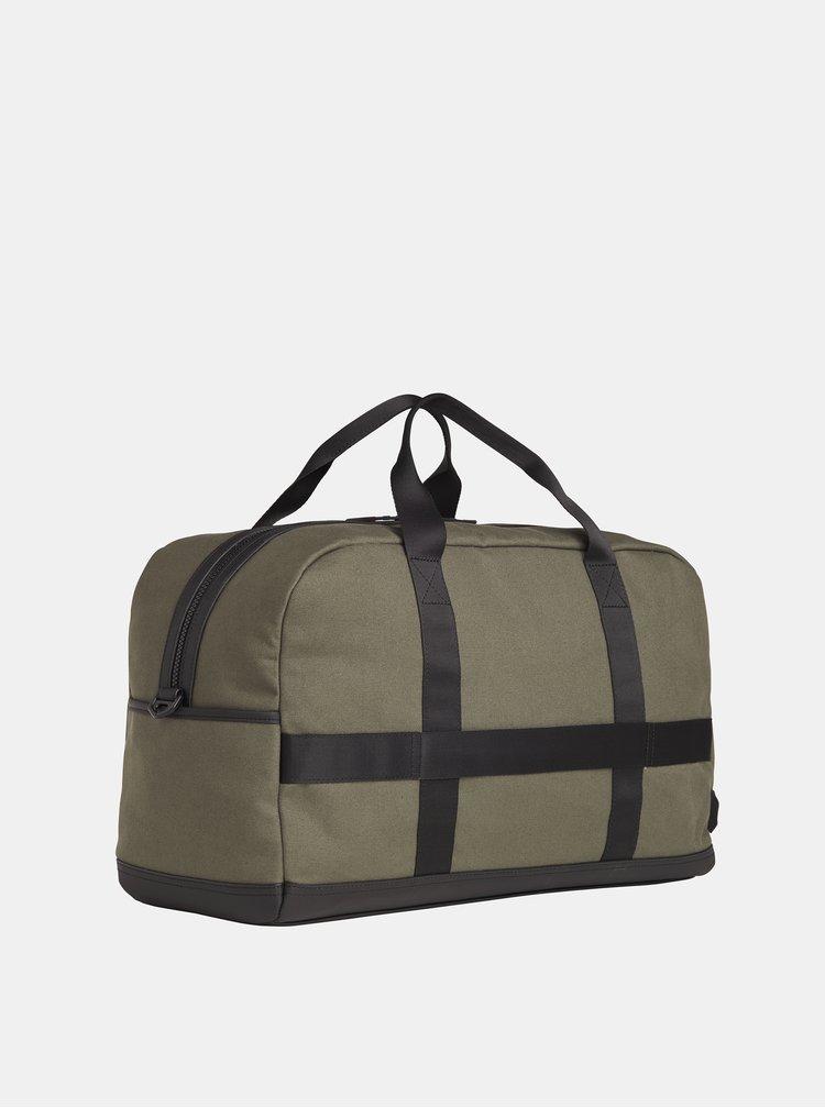 Tmavě zelená cestovní taška Tommy Hilfiger