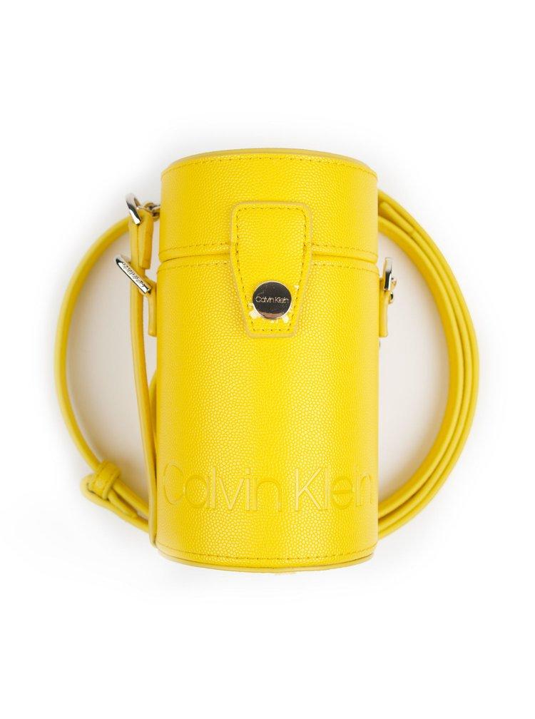 Calvin Klein žlutá malá kabelka Drum Cylinder Crossbody CAV