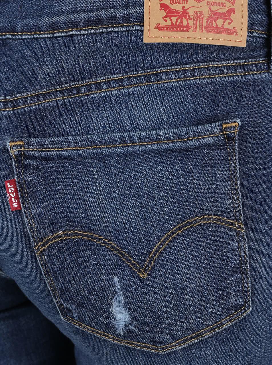 60ddc49caf6e Tmavě modré dámské skinny džíny s potrhaným efektem Levi s® 711 ...