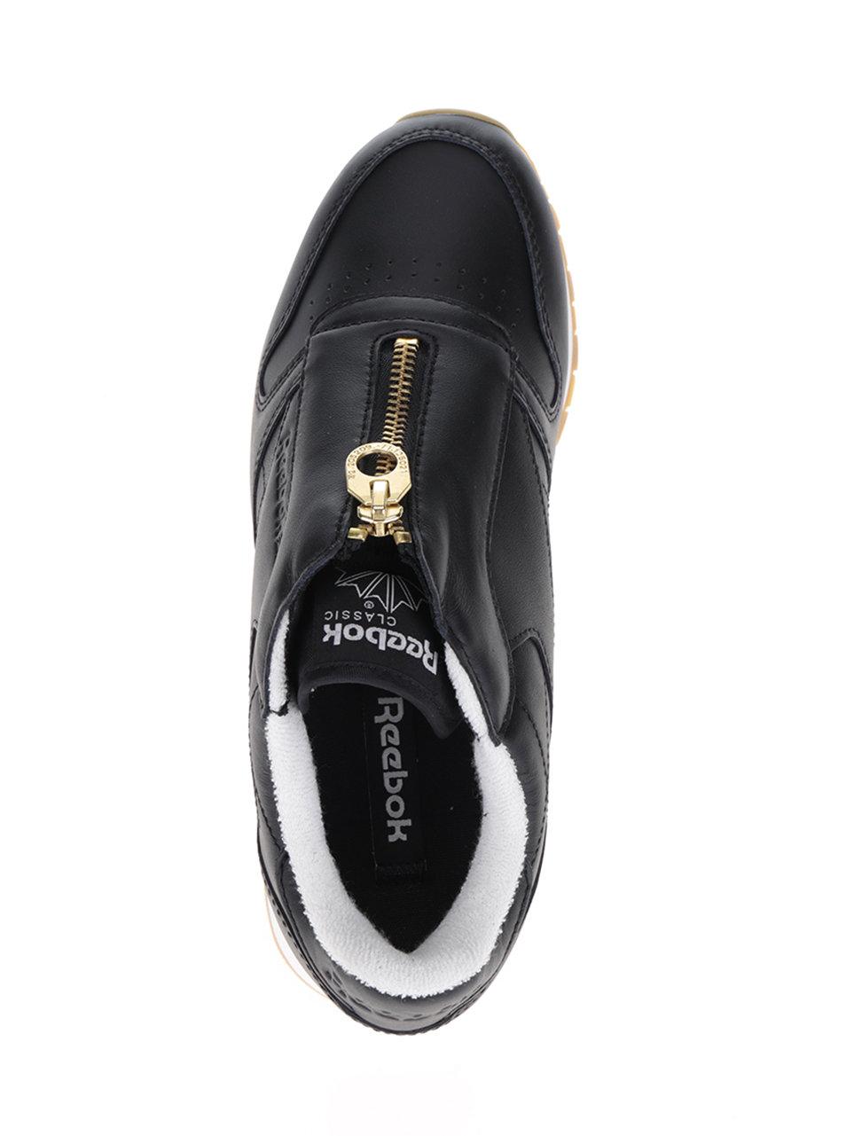 ff67a0cf2d Čierne dámske tenisky so zipsom v zlatej farbe Reebok ...