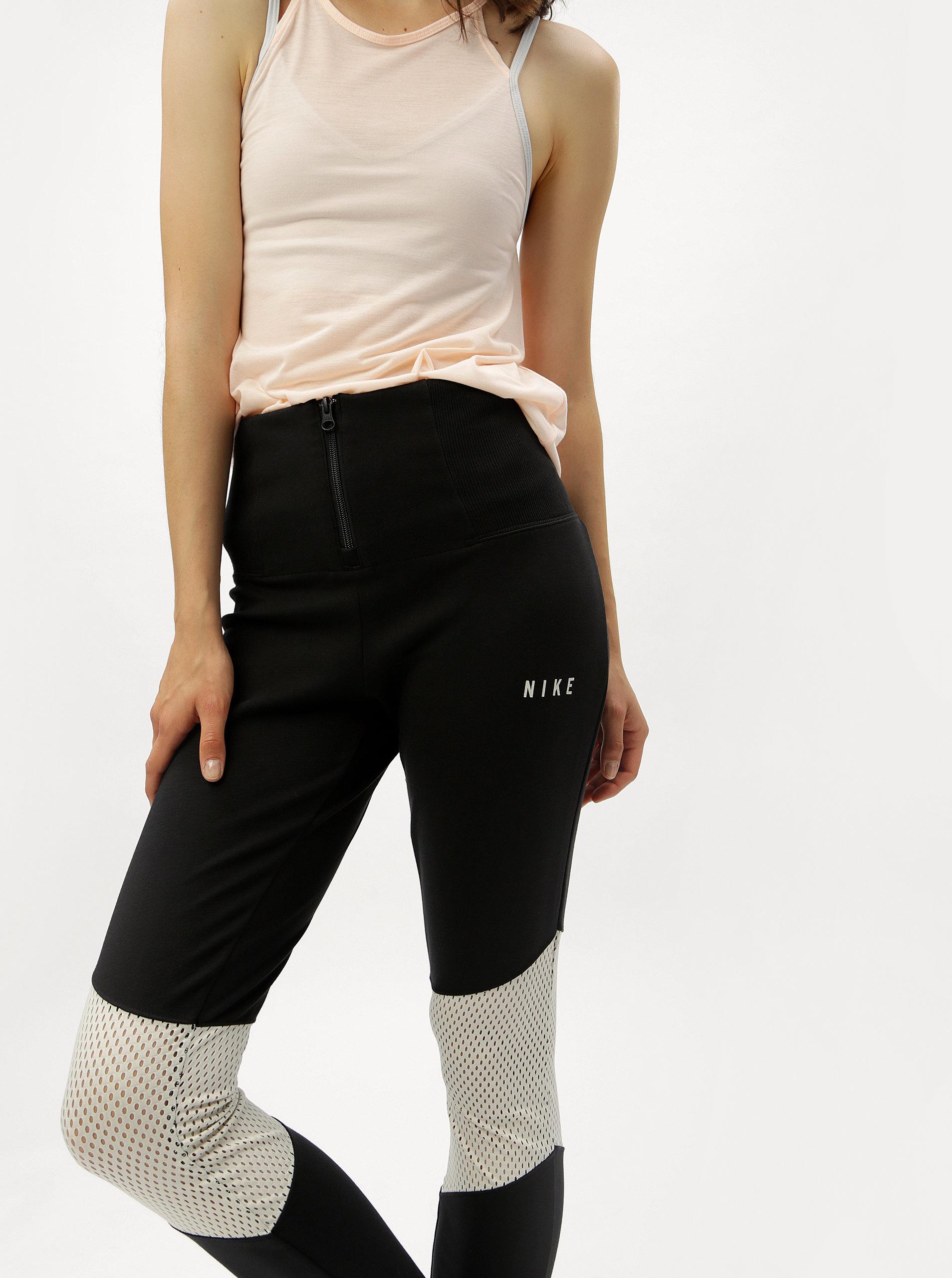 19d113a1bdf Černé dámské legíny se zipem a vysokým pasem Nike ...