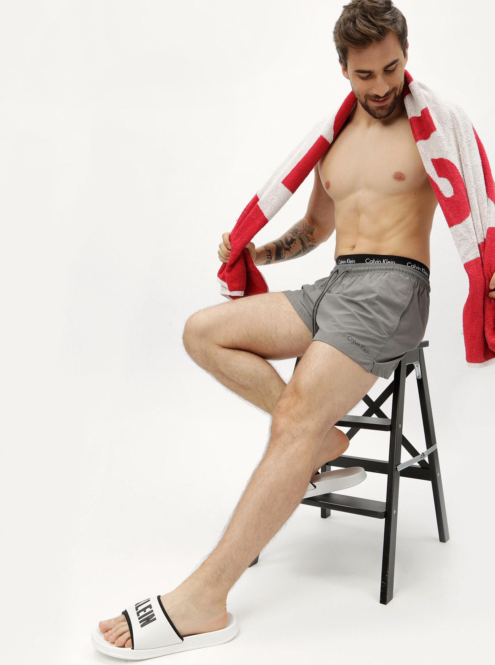 84689b41d6 Šedé pánské plavky s gumou v pase Calvin Klein Underwear ...